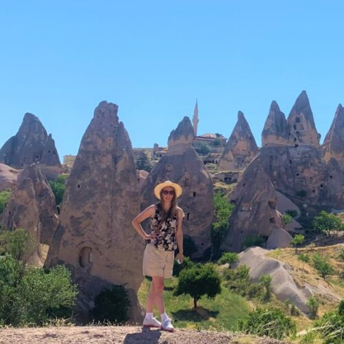 standing in front of amazing formations in Cappadocia Turkey on a 2 day itinerary