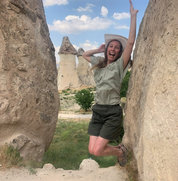 jumping in rocky landscape in cappadocia turkey during 2 day trip