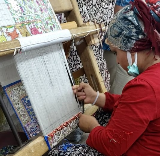 expert Weaving a Turkish Rug in anatolia at a turkish rug demonstation
