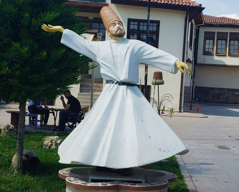 Statue of a Whirling Dervish in white skirt in Turkey