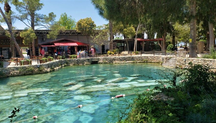 pool of crystal water and ancient pillars at Cleopatras Pool in Pamukkale in Turkey