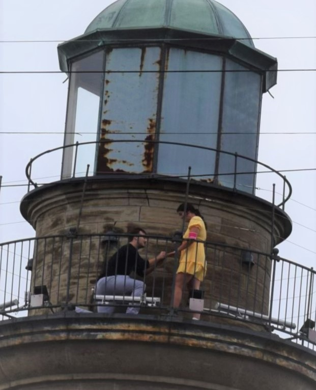 man proposing on top of the lighthouse at Fairport Harbor Beach near Lake Erie