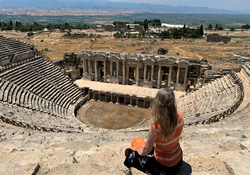 sitting on top of ancient theater seats at Hieroplois in Turkey