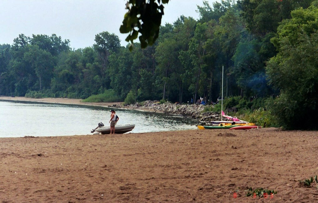 boat and person on Kelleys Island State Park Beach near Cleveland