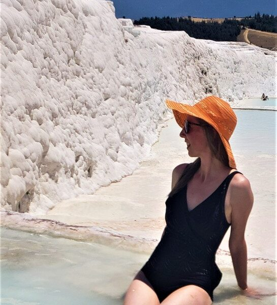sitting in a pool of water at Pamukkale on a small group tour in turkey