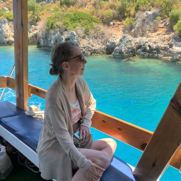 watching the landscape during sunken city boat tour in turkey
