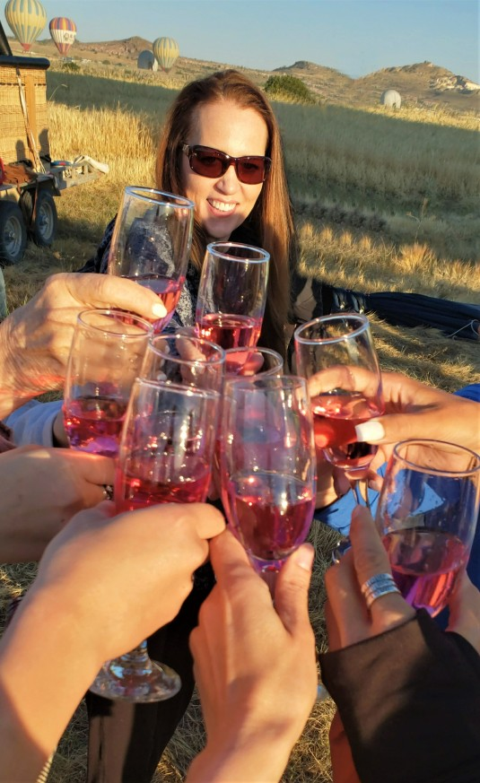 wine glasses toasting the successful landing of a Cappadocia hot air balloon in turkey