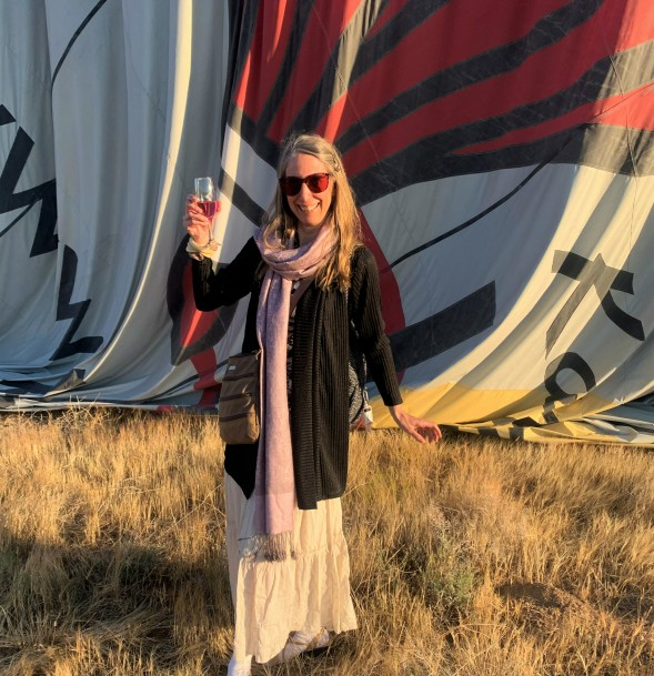 a lady toasting with champagne after a Cappadocia balloon ride in turkey