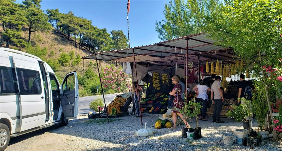 fruit stand vendor with small van parked out in front on a small group tour in Turkey