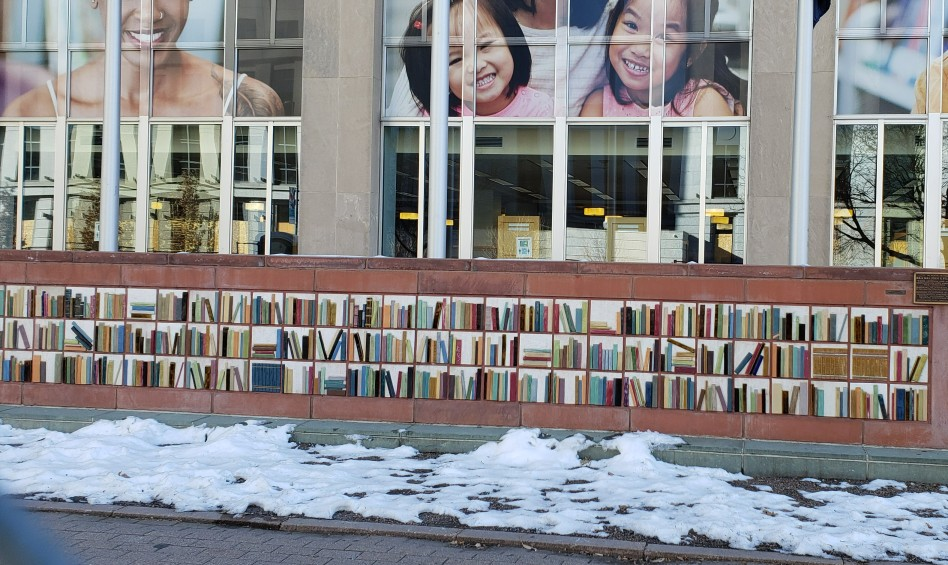 mural of books at Denver Library in Winter