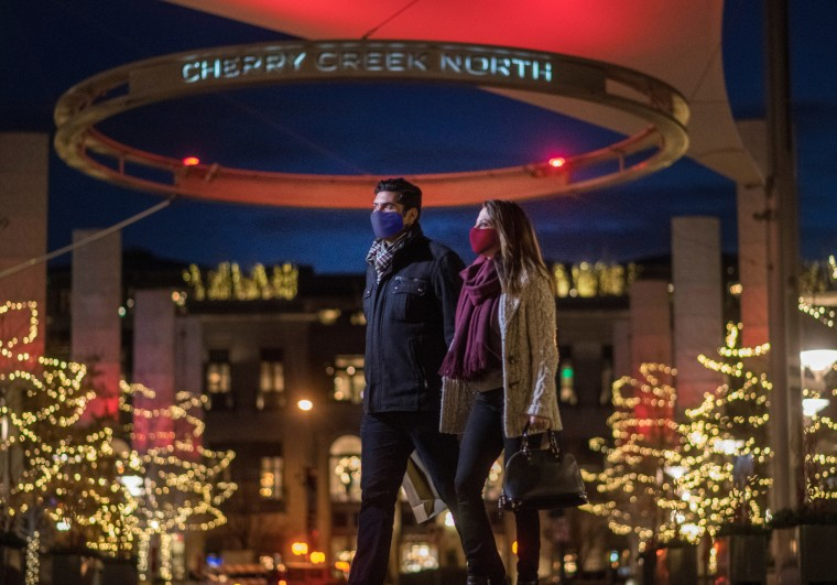 couple walking in shopping mall at christmas in Denver at Cherry Creek Mall